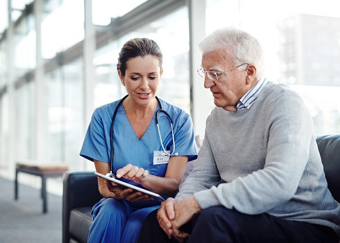 Image of health professional speaking to a patient